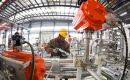 Industrial output grew 5% in May from a year earlier, data from the National Bureau of Statistics showed on Friday, missing analysts' expectations of 5.5%
