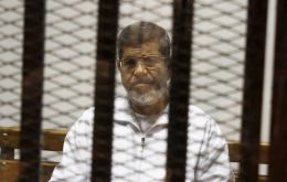 The imprisoned former elected Egyptian president Mohammed Morsi died in a Cairo hospital after fainting during a court session.