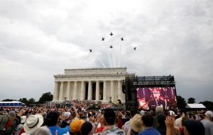 "Thousands of supporters with Trump's signature ""Make America Great Again"" hats poured into Washington despite scorching temperatures and intermittent rain."