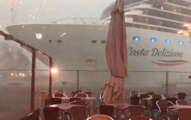 The 12-deck Costa Deliziosa, nearly 300 meters long was being towed out in stormy conditions when the incident happened.
