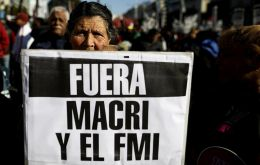 On the streets of Buenos Aires, protesters brandished banners slamming Macri's economic austerity policies, rising poverty, and the IMF
