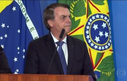 """We appeal to appear in green and yellow. We want to show the world that the Amazon is ours,"" Bolsonaro said in a ceremony at the Planalto Palace."