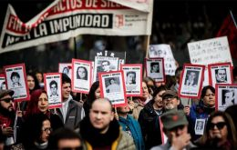 The protest began in central Santiago, with many demonstrators carrying red carnations and holding photos of loved ones who were killed or disappeared