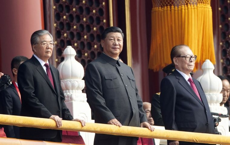 "Xi, dressed in a slate grey ""Mao"" suit and accompanied by his predecessors Hu Jintao and Jiang Zemin, said China would pursue a mutually beneficial strategy of opening up"