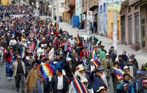 """Protestors flooded streets of La Paz and its sister city El Alto, a Morales stronghold, waving the multicolored indigenous flag and chanting, """"Now, civil war!"""""""