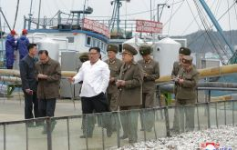 Kim's visit to the fish processing plants was splashed across a two-page spread in state newspaper Rodong Sinmun
