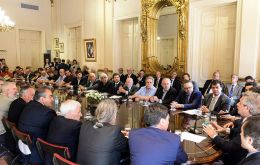 President Alberto Fernandez with ministers and representatives from different organizations and unions during discussion at Government House