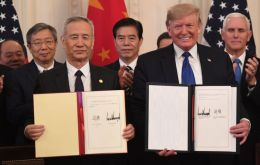 Donald Trump and Vice Premier Liu He on Wednesday signed a deal that will roll back some tariffs and see China boost purchases of U.S. goods and services