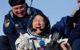 Koch was shown seated and smiling broadly after being extracted from the Soyuz descent module in the Roscosmos space agency's video footage