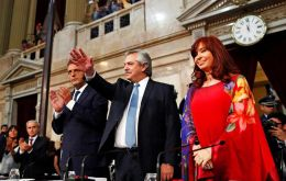 President Fernandez next to his mentor Cristina Kirchner and the head of the Lower House, Sergio Massa, addressing Congress