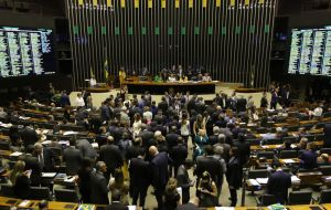 In a year of local elections, lawmakers are worried about voter rejection over austerity measures and overturned Bolsonaro's veto by 303 votes against 137.