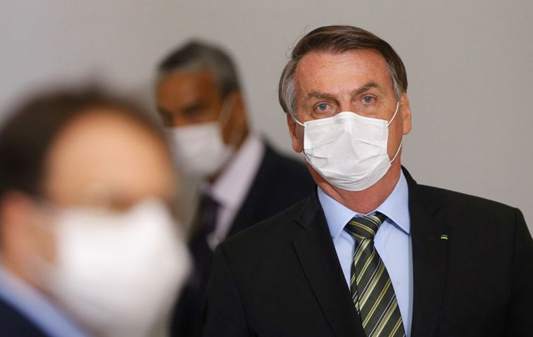 With criticism mounting, Bolsonaro held a news conference with ministers - all wearing masks - to announce emergency measures to buttress the economy