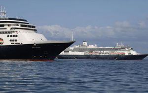The Zaandam was anchored outside Panama Canal waters, where healthy passengers were being transferred Sunday to Holland America's Rotterdam.