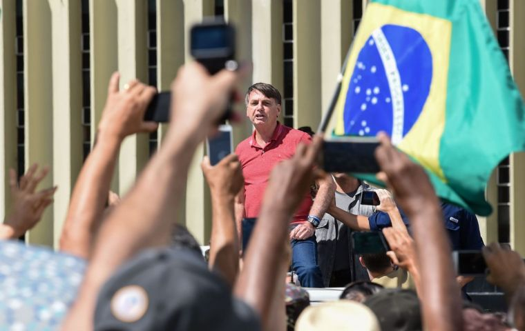 Bolsonaro, (not wearing a face mask), addressed a crowd of a few hundred in Brasilia, many of them wearing Brazil's yellow-and-green soccer jersey.