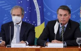 Speaking next to president Bolsonaro, Guedes  (L) said that Brazil does not want to become an Argentina or a Venezuela.