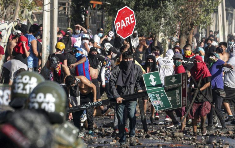 Overnight Monday rioters looted gas stations, while downtown a mob set a bus ablaze. Residents middle-class neighborhoods banged pots and pans in protest.