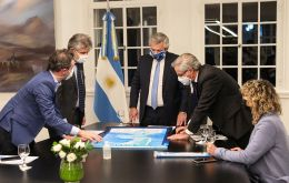 Argentine president Alberto Fernandez and Foreign minister Felipe Solá at the Olivos residence with a display of South Atlantic charts