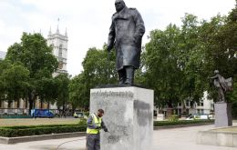 The World War Two leader's statue was sprayed with graffiti declaring Churchill a racist during a fractious end to a mostly peaceful demonstration on Sunday