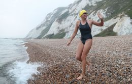 Chloe McCardel, from Sydney, completed her 35th swim across the world's busiest shipping lane after emerging on the northern French shoreline in Sunday