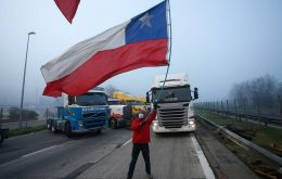 Several points of the main highway headed south were also blocked by trucks parked across the road as drivers stood alongside with Chilean flags