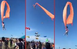 It took some 30 seconds before the girl's nightmare ended and she was pulled back to the ground by members of the crowd as the kite was brought under control