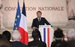 In the Paris Pantheon, a mausoleum to France's heroes, Macron handed five new citizens their French papers in a solemn ceremony