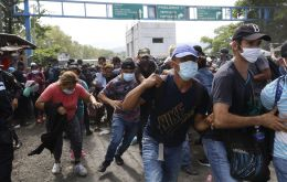 "In a televised message, president Giammattei said Guatemalan security forces were able to ""contain"" the caravan, ""a factor in the transmission of the virus"""