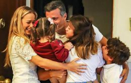 "López tweeted ""we'll continue working day and night to attain the freedom that we Venezuelans all deserve"" and on Sunday he published a photo with his wife Lilian Tintori in Madrid."