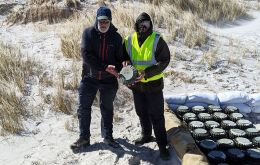 Guy Marot of Fenix Insight and John Hare of SafeLane Global holding the last mine removed from the ground and which will be detonated this Saturday in a special celebration (Pics G. Marot)