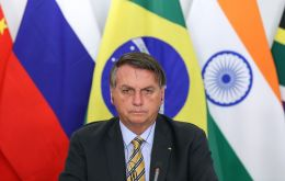 Addressing a BRICS summit, Bolsonaro said Brazilian police had developed a way of tracking wood exported from the Amazon using isotopes.