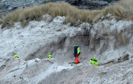 A team of Zimbabweans working in the clearance of mines in the Falklands. Unearthing 20,000 antipersonnel and 5,000 mines took eleven years