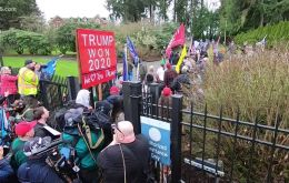 Hundreds of Trump supporters broke through the gates of the Washington governor's mansion complex in Olympia late Wednesday, flooding the lawn