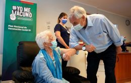 "As the first doses were applied at a vaccination center in Futrono, Piñera described the campaign as a ""tremendous challenge."""