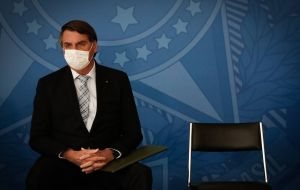 Bolsonaro is telling governors to allow business activities to re-open across the country arguing the economic toll overshadows the effects of the disease