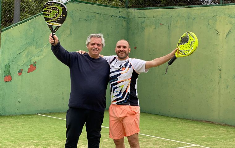 """""""I am physically well,"""" said Fernández in the last hour of his 62nd birthday, in the photo with his Minister of Economy Martin Guzman during a paddle tenis match. (Pic M_Guzman Twitter)"""