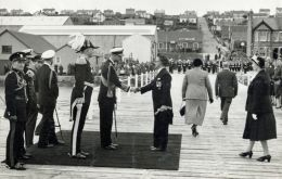 Prince Philip being welcomed on the Public Jetty on his arrival at Stanley 1957. (Courtesy of British Antarctic Survey Archives)
