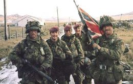 John Geddes (with Union Jack) and fellow Paras after their hard-won victory in the Falklands