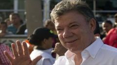 President Santos promised he would be early morning Tuesday to participate in the march